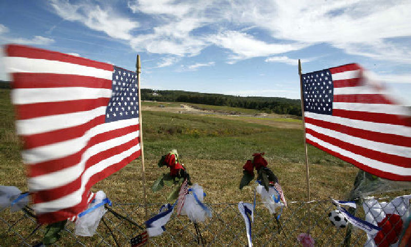 Flags frame the crash site of United Flight 93 on Sept. 11, 2010, at the temporary Flight 93 memorial in Shanksville.