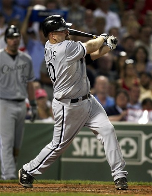 Chicago White Sox's Kevin Youkilis hits a three-run home run off a pitch by Boston Red Sox's Jon Lester in the fourth inning of a baseball game in Boston, Tuesday, July 17, 2012. (AP Photo/Steven Senne)