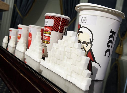 A display of various size cups and sugar cubes is displayed at a news conference at New York's City Hall. The city Board of Health is scheduled to hold a hearing today on the proposal to ban the sale of sugary drinks larger than 16 ounces at city restaurants, movie theaters and other eateries.