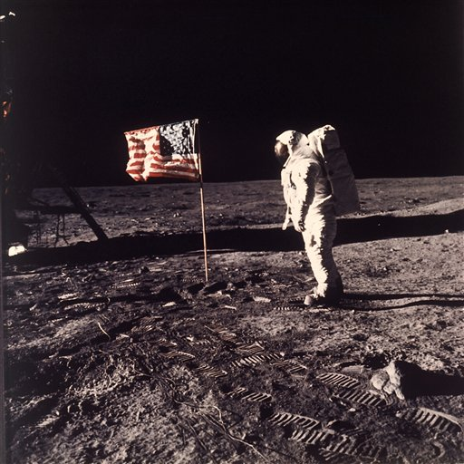 "This July 20, 1969 file photo released by NASA shows astronaut Edwin E. ""Buzz"" Aldrin Jr. posing for a photograph beside the U.S. flag deployed on the moon during the Apollo 11 mission. Aldrin and fellow astronaut Neil Armstrong were the first men to walk on the lunar surface. Sony Electronics and the Nielsen television research company collaborated on a survey ranking TV's most memorable moments. Other TV events include, the Sept. 11 attacks in 2001, Hurricane Katrina in 2005, the O.J. Simpson murder trial verdict in 1995 and the death of Osama bin Laden in 2011. (AP Photo/NASA/Neil A. Armstrong, file)"