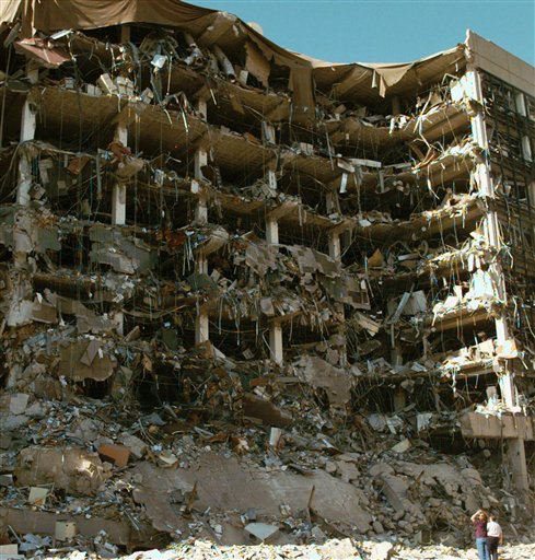 This April 19, 1995 file photo shows rescue workers standing in front of the Alfred P. Murrah Federal Building following an explosion in downtown Oklahoma City. Sony Electronics and the Nielsen television research company collaborated on a survey ranking TV's most memorable moments. Other TV events include, the Sept. 11 attacks in 2001, Hurricane Katrina in 2005, the O.J. Simpson murder trial verdict in 1995 and the death of Osama bin Laden in 2011. (AP Photo/David Longstreath, File)