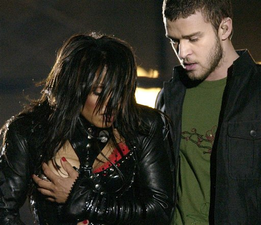 In this Sunday Feb. 1, 2004 file photo, entertainer Janet Jackson, left, covers her breast after her outfit came undone during the half time performance with Justin Timberlake at Super Bowl XXXVIII in Houston. Sony Electronics and the Nielsen television research company collaborated on a survey ranking TV's most memorable moments. Other TV events include, the Sept. 11 attacks in 2001, Hurricane Katrina in 2005, the O.J. Simpson murder trial verdict in 1995 and the death of Osama bin Laden in 2011.(AP Photo/David Phillip, File) super;bowl;entertainment;halftime;superbowlentertainment