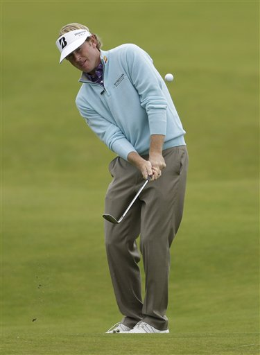 Brandt Snedeker of the United States plays shot on the seventh hole at Royal Lytham & St Annes golf club during the second round of the British Open Golf Championship, Lytham St Annes, England, Friday, July 20, 2012. (AP Photo/Peter Morrison)