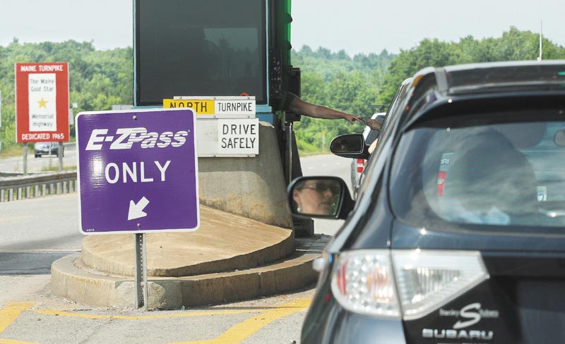PAYING THE TOLL: Motorists in the northbound lane of I-295 enter the Gardiner toll station on Monday.