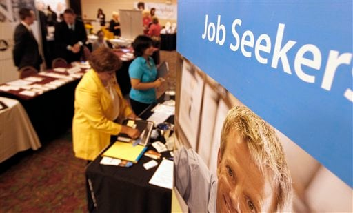 People walk by the recruiters at a jobs fair in the Pittsburgh suburb of Green Tree, Pa., in this Tuesday photo.
