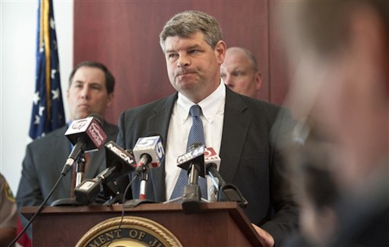 "U.S. Attorney Tristan Coffin speaks at a news conference about a missing couple in Burlington, Vt., Friday, July 20, 2012. A Vermont couple missing for more than a year were abducted and murdered and a suspect is in custody in another state, federal authorities said Friday. ""The person believed to have committed the murders is in custody in another state and will remain in custody,"" said Coffin. (AP Photo/Burlington Free Press, Glenn Russell)"