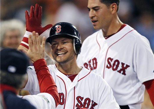 Boston Red Sox's Cody Ross, center, celebrates his three-run home run that also drove in Jacoby Ellsbury, right, in the third inning of a baseball game against the Chicago White Sox in Boston, Wednesday, July 18, 2012. (AP Photo/Michael Dwyer)