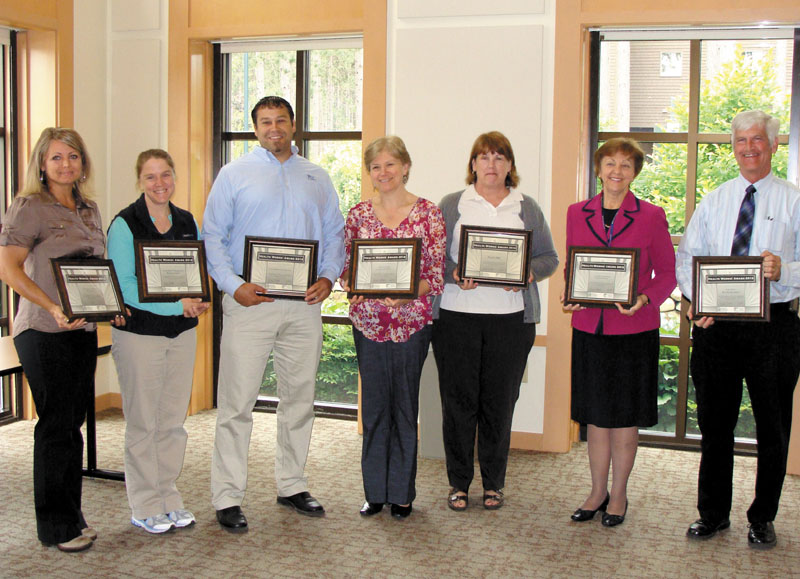WorkSite Wellness Award recipients, from left, are Tricia Thomas, University of Maine at Farmington; Rebecca Scott, HealthQuest Chiropractic; Chris Guild, Community Concepts; Ginny Andrews, Western Maine Community Action; Ann Allison, NotifyMD; Rebecca Ryder, Franklin Community Health Network; and David Robie, Star Barn Bed and Breakfast. Absent: Leap Inc., Safe Voices and town of Jay.
