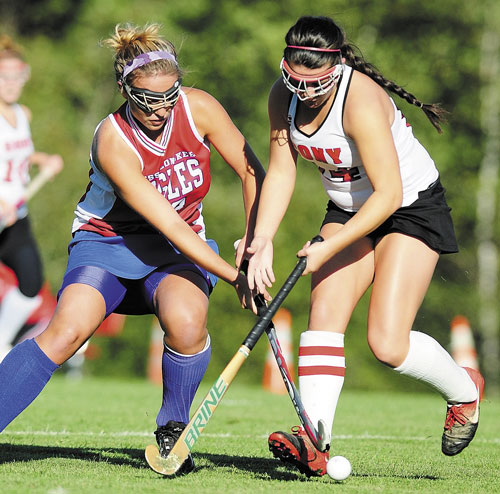 JOINING FORCES: Messalonskee's Katie Bernatchez, left, tries to get past Cony's Chelsea Begin during a game last season. Both will play in the McNally Senior All-Star Field Hockey Game on Saturday.