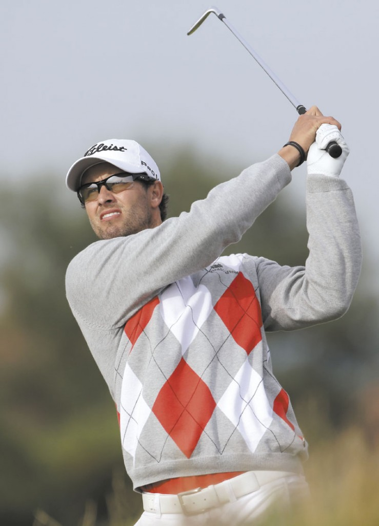 YOUR LEADER: Adam Scott plays a shot off the eighth tee Saturday at Royal Lytham & St Annes during the third round of the British Open Golf Championship. Scott has a four-shot lead headining into the final round.