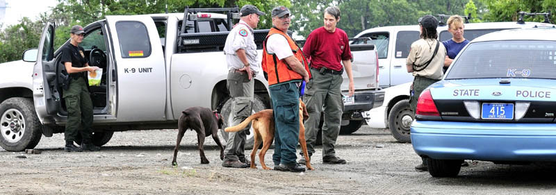 Members of Maine Search and Rescue Dogs assemble at the Pan Am railroad yard in Waterville after searching the area and riverbank for evidence of missing toddler Ayla Reynolds on Tuesday.