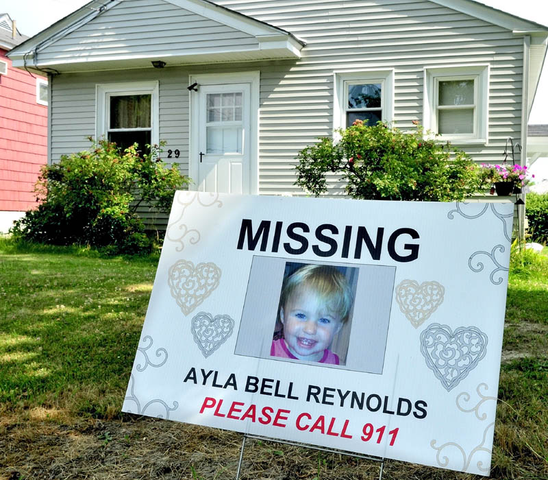 SIGN: This sign has been recently placed at 29 Violette Ave. in Waterville where Ayla Reynolds was first reported missing seven months ago today.