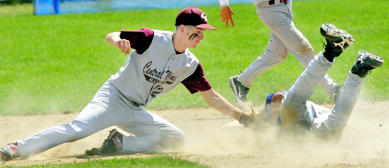 Central Maine's Ben Frazee tags out Midcoast's Andrew Hall at second base during 14-year-old Babe Ruth state championship tournament Sunday in Fairfield.