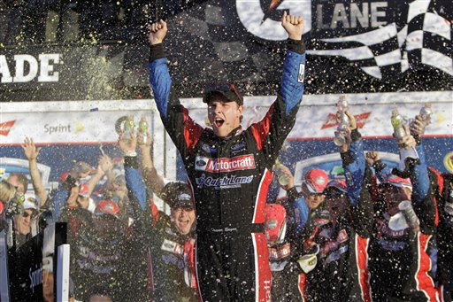 Trevor Bayne celebrates in victory lane after winning the Daytona 500 NASCAR auto race at Daytona International Speedway in Daytona Beach, Fla., Sunday, Feb. 20, 2011. Bayne has agreed to race in the TD Bank 250, Maine's premiere auto race. (AP Photo/John Raoux)