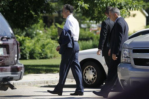 In this photo taken July 1, 2012, Republican presidential candidate Mitt Romney arrives at The Church of Jesus Christ of Latter-Day Saints in Wolfeboro, N.H. Romney, the first Mormon to clinch the presidential nomination of a major party, attended services Sunday with his wife, Ann, five sons, five daughters-in-law and eighteen grandchildren. (AP Photo/Charles Dharapak)