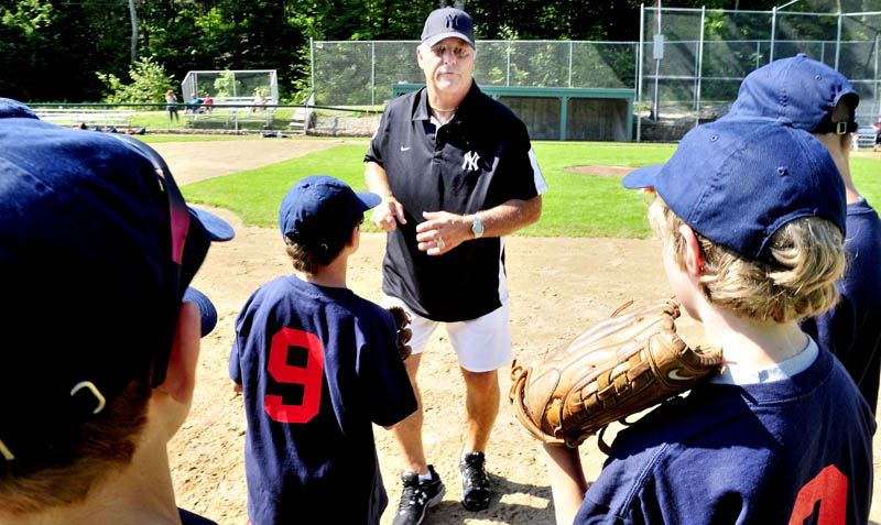 LISTEN TO THIS: Former New York Yankees player Bucky Dent gives pointers to kids during a baseball camp Monday at Little Fenway Park in Oakland.