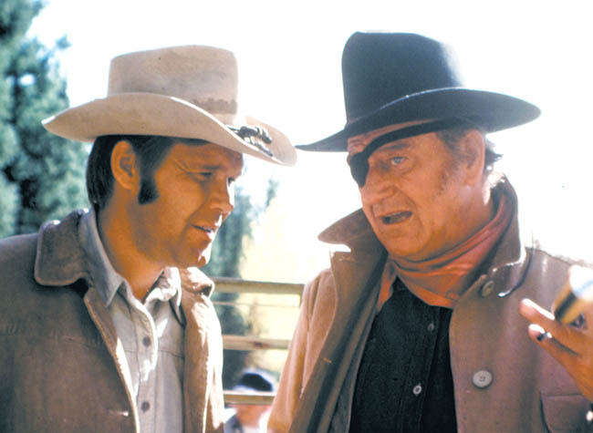 "Glen Campbell, left, in a scene from the movie ""True Grit"" with John Wayne."