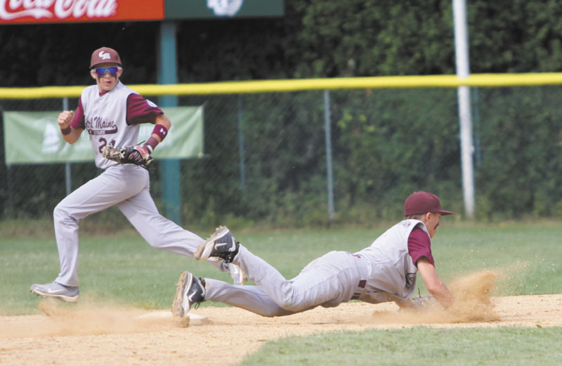 DIVING STOP: J.T. Nutting makes a diving play up the middle during Central Maine's game against Dedham, Mass. on Sunday in Winooski, Vt. hurricanes regional 2