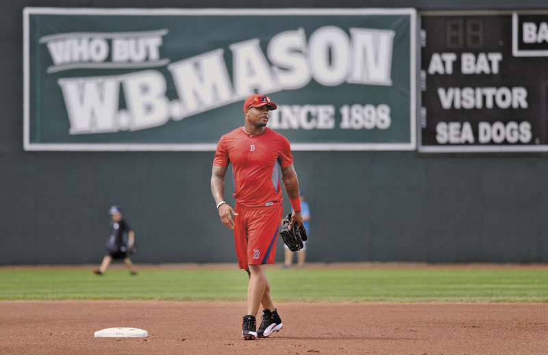 Boston Red Sox outfielder Carl Crawford gets familiar with Hadlock Field in Portland on Wednesday as he prepares for a rehab appearance with the Sea Dogs