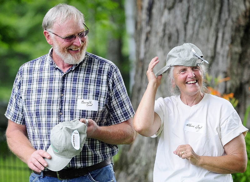 Dairy farmers Berndt and Elaine Graf joke around with the Kennebec Land Trust hats they were given during a ceremony on Saturday morning at the Fayette Corner Baptist Church.