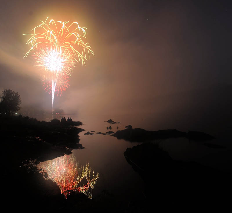 Staff photo by Michael G. Seamans Fireworks light up the sky over the Kennebec River during Independence Day celebration in Winslow in 2011.