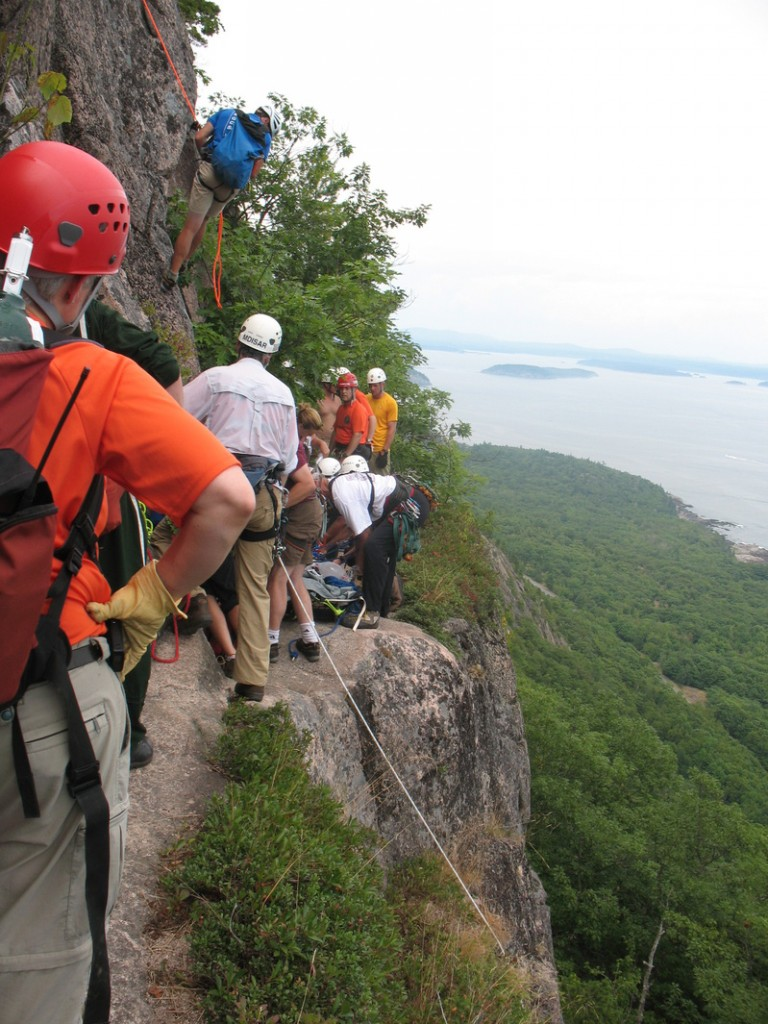 Rescuers use ropes and pulleys to haul injured hiker Shirley Ladd up Champlain Mountain in Acadia National Park on Saturday. Ladd later died at the hospital.