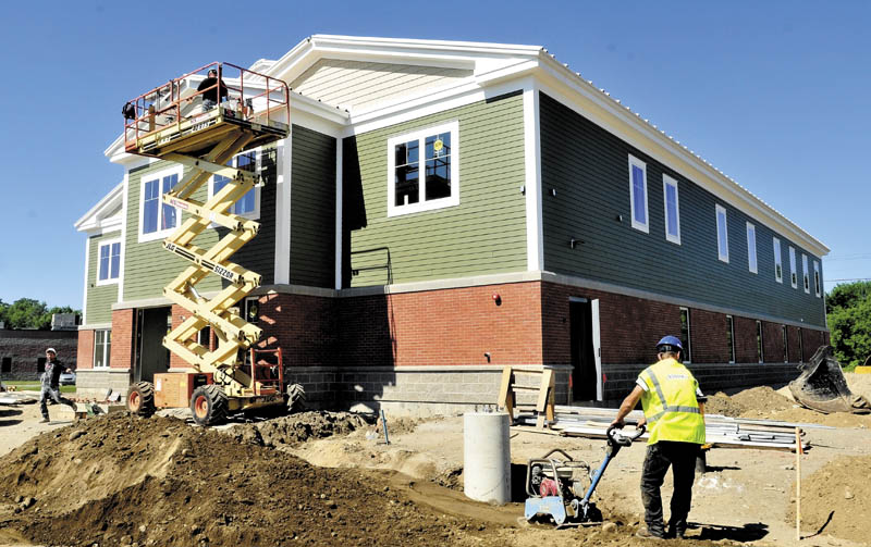 Workers continue building the new Mid-Maine Homeless Shelter off Colby Street in Waterville last week.