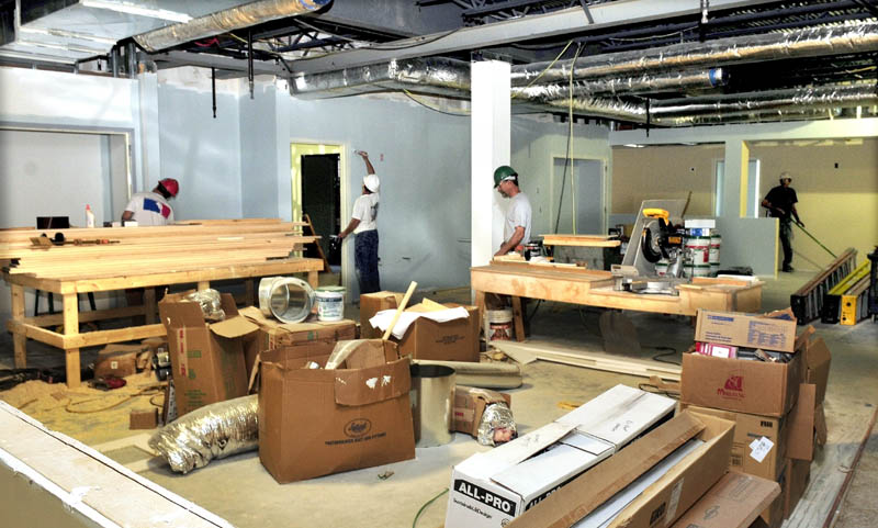 Workers are shown in the large kitchen area at the new Mid-Maine Homeless Shelter in Waterville last week.