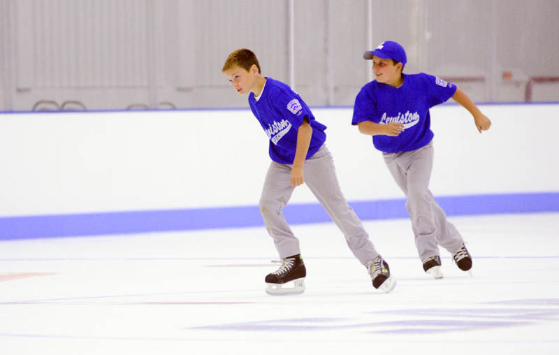 Owen Cox, left, and Ryan Pomerleau try out the new ice in The Bank of Maine Ice Vault on Saturday in Hallowell. They had on baseball cleats while taking the tour and co-owner Peter Prescott suggested that the borrow some rental skates and try it out, so they did.