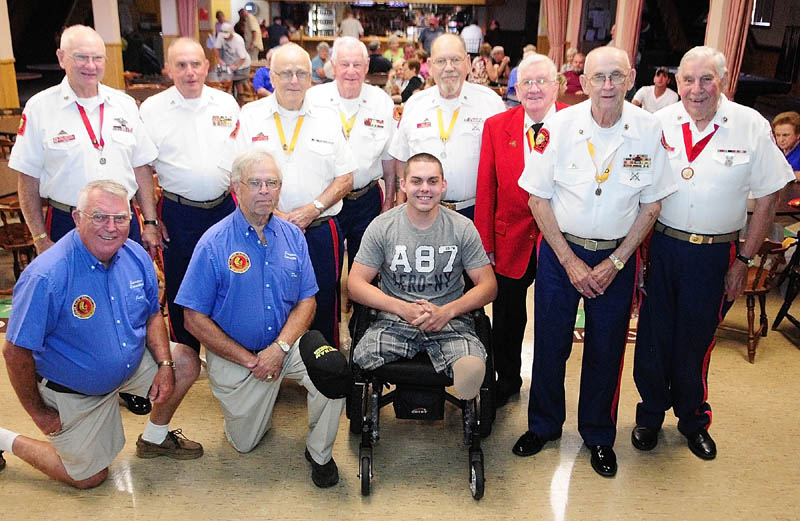 Jeremy Gilley, center, poses for a group shot with members of Le Club Calumet and Marine Corps League Detachment # 599 at a fundraiser held on Wednesday night at Le Club Calumet in Augusta. Gilley received donations from the Marine Corps League and the Club.