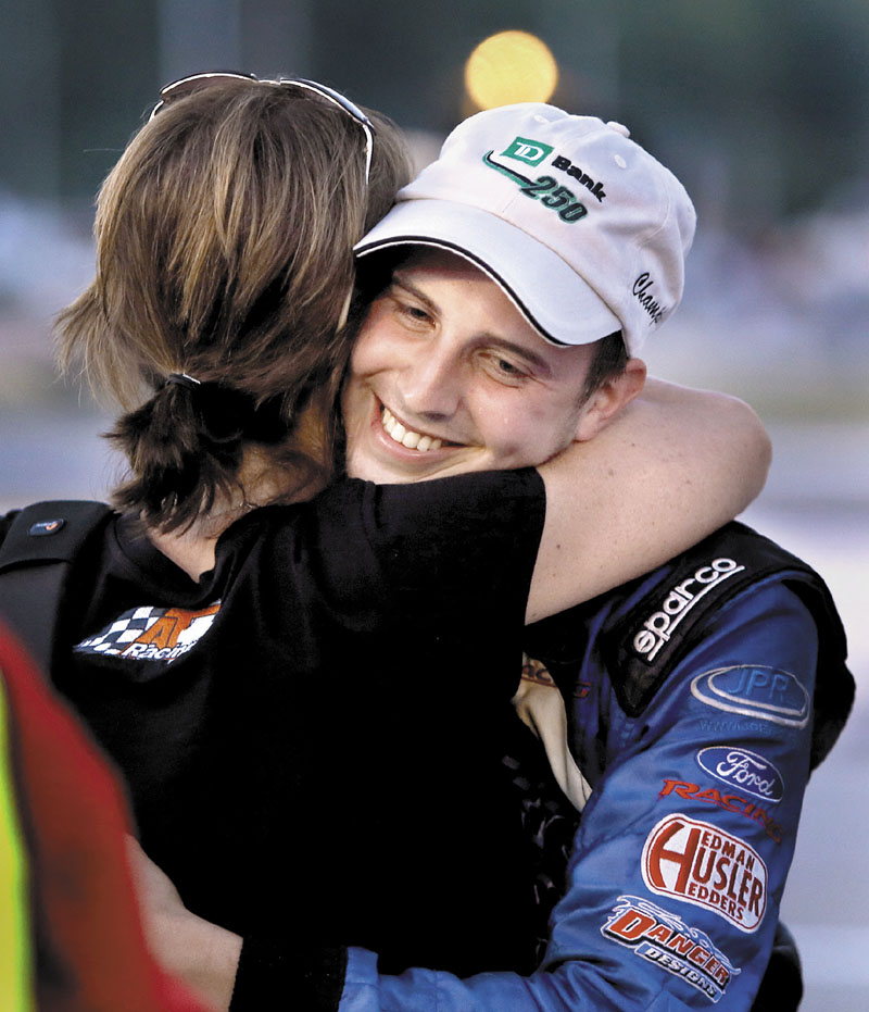 CONGRATS: Joey Polewarczyk, Jr. hugs his soon to be mother-in-law Terry Theriault after winning the TD Bank Oxford 250 on Sunday at Oxford Plains Speedway in Oxford.