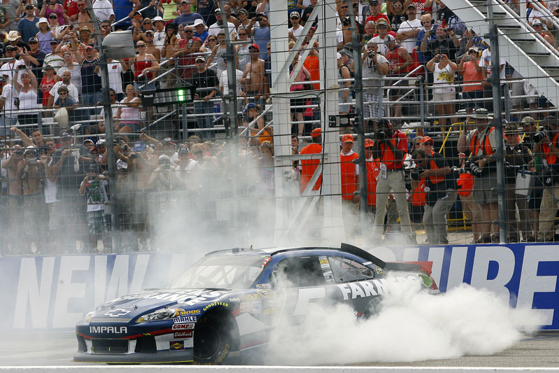 UP IN SMOKE: Kasey Kahne performs a burnout after winning the NASCAR Sprint Cup Series race at New Hampshire Motor Speedway on Sunday in Loudon, N.H.