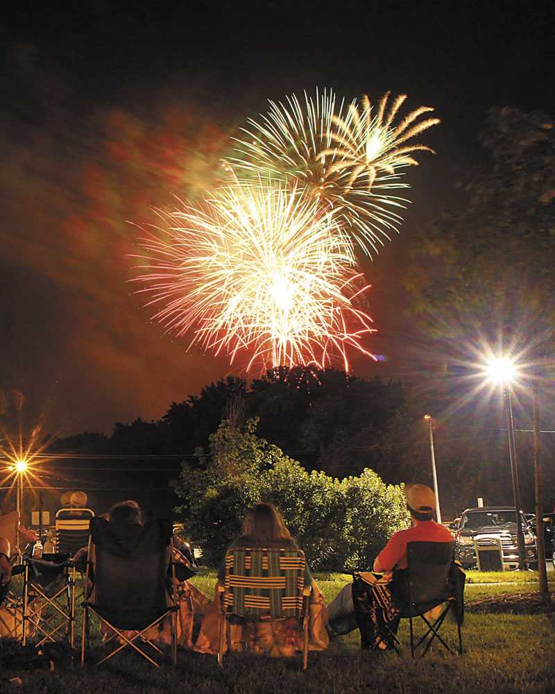 LIGHTING IT UP: Fireworks light up the sky over the Hathaway Creative Center in Waterville on Wednesday night. The fireworks show was part of the Winslow Family 4th of July Celebration.