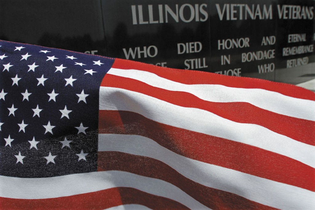 A United States flag blows in the wind near the Illinois Vietnam Memorial on Tuesday in Springfield, Ill. Today is a day when some ponder on what the Fourth of July means.