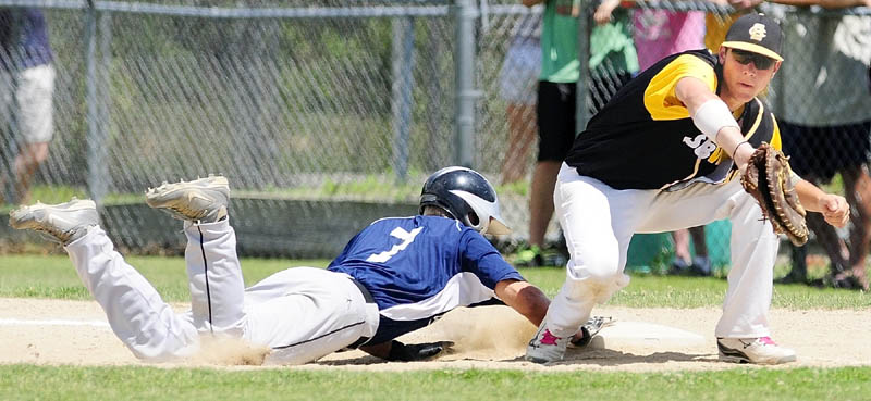 SAFE: Gardiner's Kyle Fletcher, left, dives back safely as South China first baseman Jory Humphrey fields a pickoff throw during an American Legion Zone 2 tournament game Saturday in Augusta.
