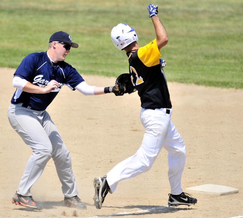 Gardiner first baseman Spencer Allen, left, tags out South China hitter Shyler Scates during the American Legion baseball tourney on Saturday in Augusta.