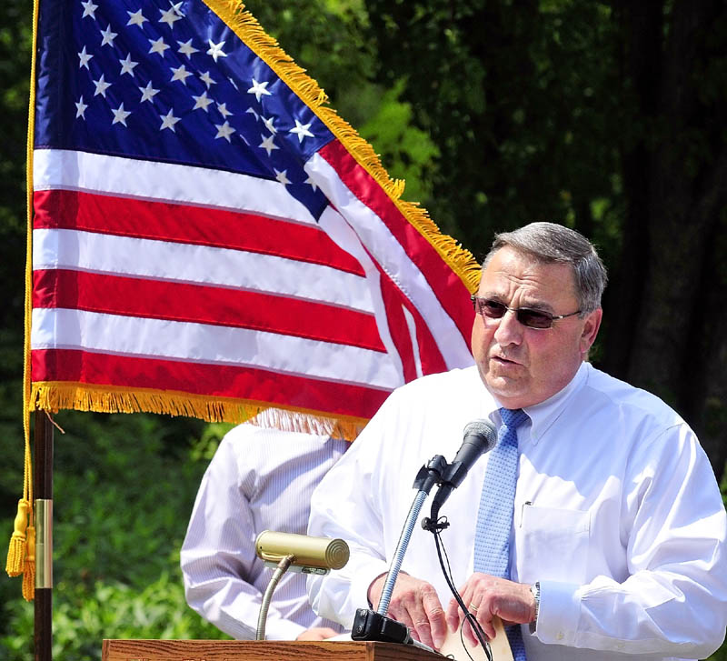 Staff photo by Joe Phelan Gov. Paul LePage speaks at a POW/MIA event on Wednesday at Blaine House in Augusta.