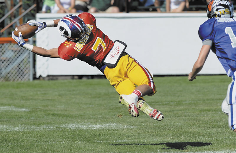DIVING GRAB: Sam Dexter of Messalonskee makes a diving catch in first half of the Maine Shrine Lobster Bowl on Saturday at Waterhouse Field in Biddeford. Dexter caught eight passes for 87 yards and a touchdown in the East's 48-24 loss.