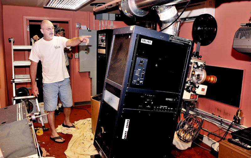Head projectionist Rick Harmon helps install permanent projectors inside the Waterville Opera House on Thursday that will be used for the Maine International Film Festival.