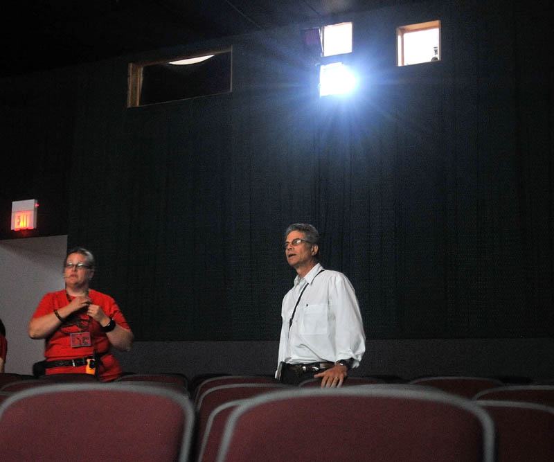 HERE WE GO: Director Richard Kane, right, goes through a sound and visual check with Serena Sanborn at Railroad Square Cinema in Waterville on Friday.