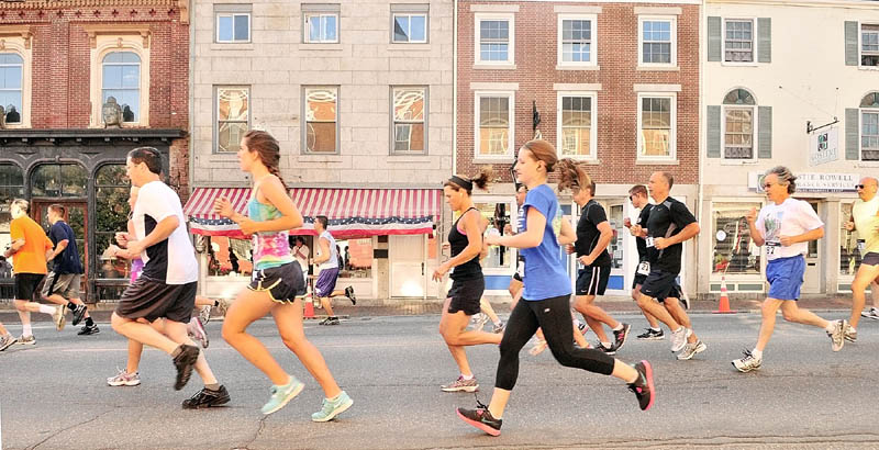 Runners head north on Water Street at the start of the Old Hallowell Day 5k race on Saturday in Hallowell. Later in the morning, there was a larger crowd of spectators as a parade went in the opposite direction.