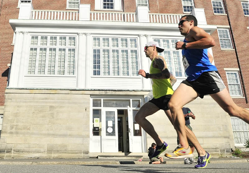 Seth Hasty, left, and Joe Viselli were neck and neck as they headed south on Second Street about half way through the Old Hallowell Day 5K on Saturday morning in Hallowell. Hasty pulled ahead for the win with a time of 17 minutes,17 seconds. Viselli finished second with a time of 17:35.