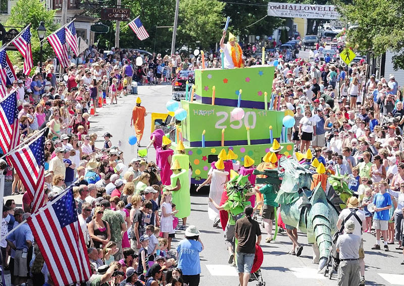 Dancing candles and dragons following a giant birthday cake for the city's 250th birthday was this year's entry from the No Ha neighborhood group in the Old Hallowell Day parade along Water Street on Saturday morning.