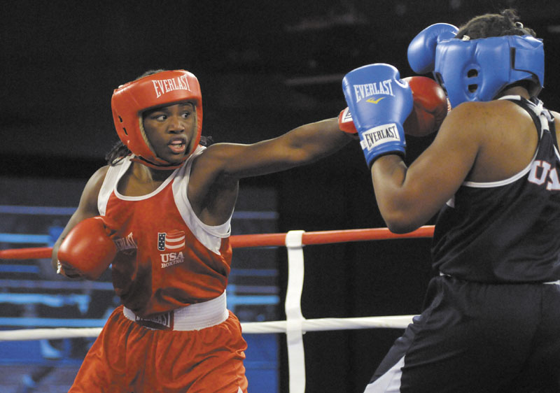 AN OLYMPIC FIRST: Claressa Shields, left, is one of a crowd of female athletes grabbing the limelight at the 2012 London Olympics Games, which are quickly shaping up as a watershed for women's sports.
