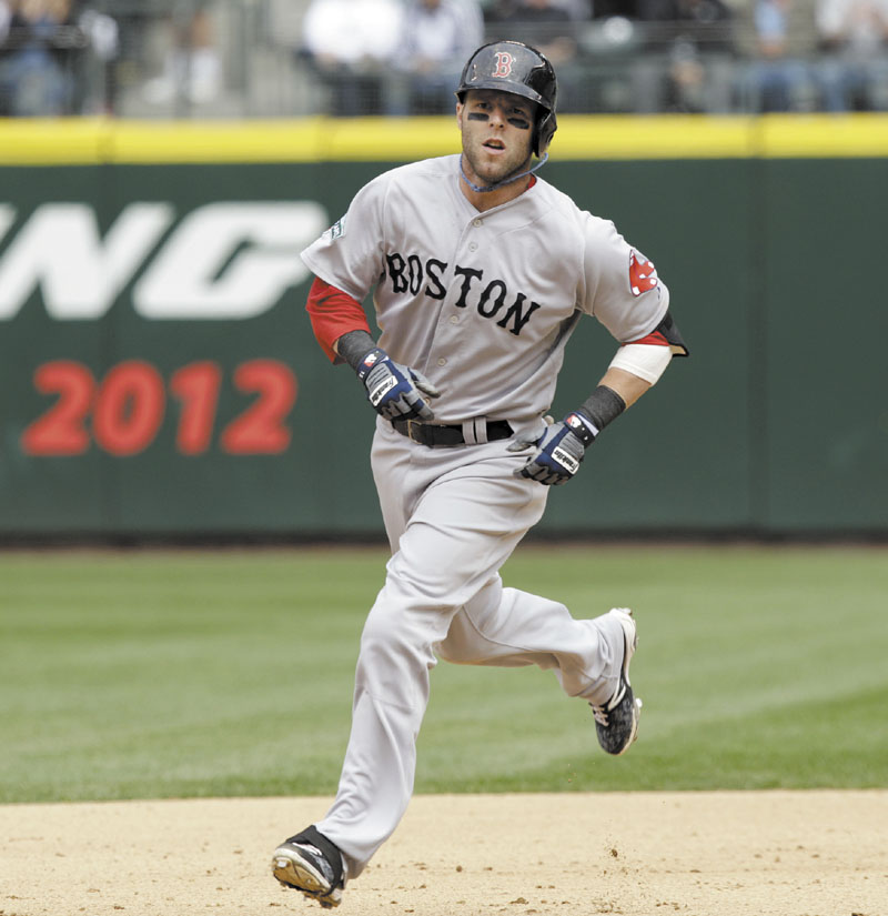 BIG BLAST: Boston's Dustin Pedroia rounds the bases after hitting a solo home run to tie the game at 1 against Seattle on Sunday in Seattle. The Red Sox went on to beat the Mariners 2-1 in 10 innings.