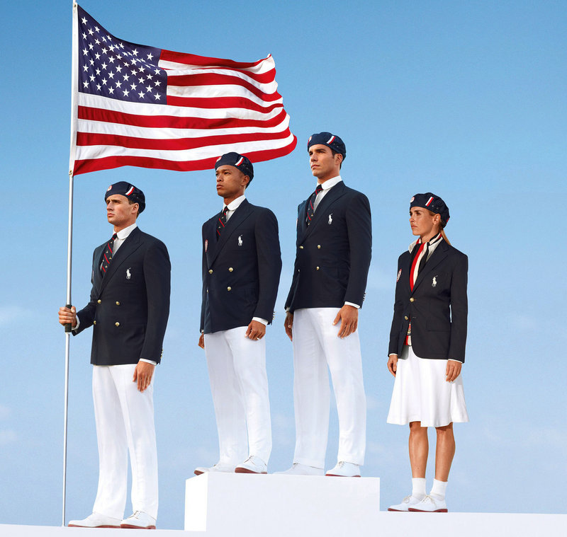 This product image released by Ralph Lauren shows U.S. Olympic athletes, from left, swimmer Ryan Lochte, decathlete Bryan Clay, rower Giuseppe Lanzone and soccer player Heather Mitts modeling the the official Team USA opening ceremony parade uniform, which was made in China.