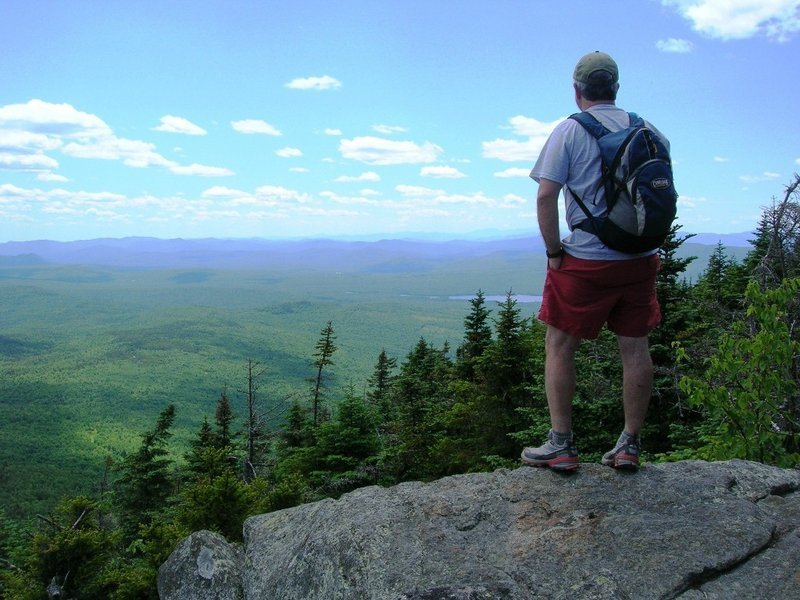 Carey Kish of Bowdoin looks out from the summit of Mt. Blue, where the views include Saddleback, Abraham, Spaulding and Sugarloaf mountains, as well as the Presidential, Carter and Mahoosuc ranges.