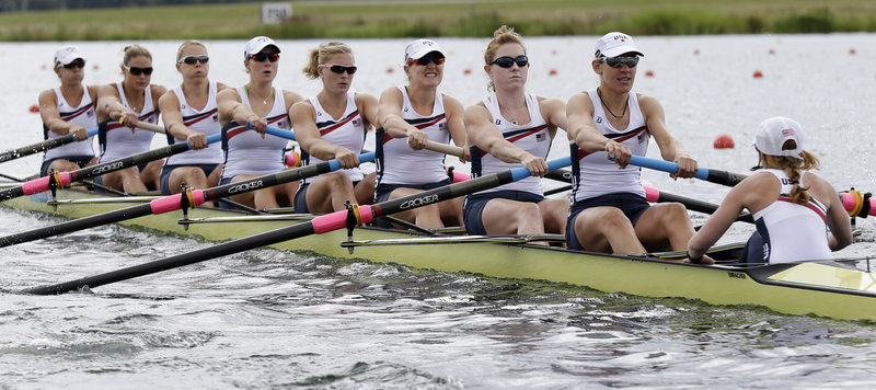Eleanor Logan, sixth from left, and her teammates in the U.S. women's eight boat qualified for Thursday's Olympic final by winning their heat Sunday, by a margin of more than six seconds. Logan, of Boothbay Harbor, is seeking a second gold medal as part of a team that hasn't lost in seven years.