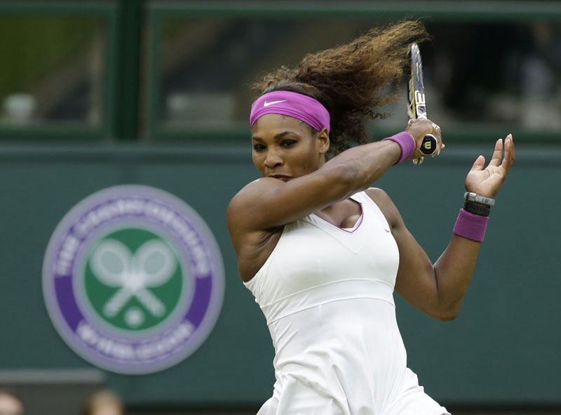 MOVING ON: Serena Williams hits a forehand to Petra Kvitova during their quarterfinals match Tuesday at the All England Lawn Tennis Championships at Wimbledon, England. Williams beat the defending champ 6-3, 7-5.