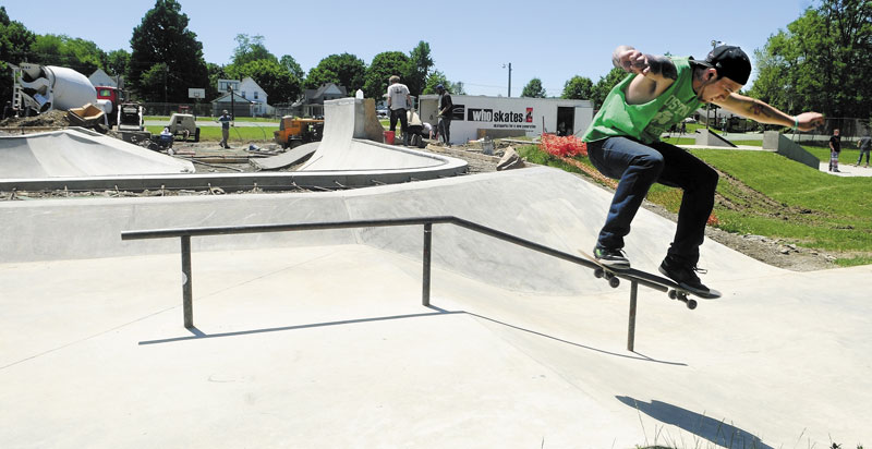 A PLACE TO SKATE: Nolan Brann of Augusta skateboards at the Augusta Skate Park as the Who Skates crew continues building the phase two bowl section in the background in June. Work on the park has been completed and a number of skaters took advantage on the park Monday.